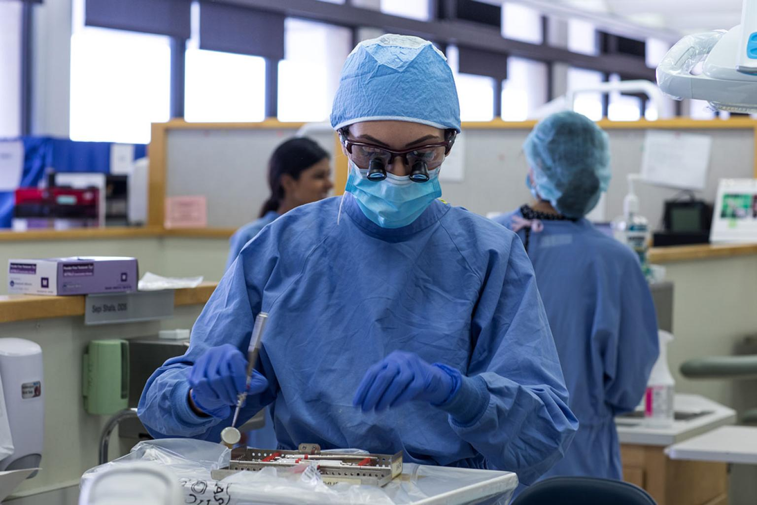 woman in scrubs and PPE